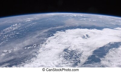 Clouds are visible near Planet Earth from window of satellite