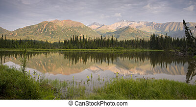 Alaska Route 1 - A tarn along the Chugach Mountains and Hwy...