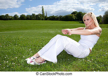 Young attractive blonde exercising