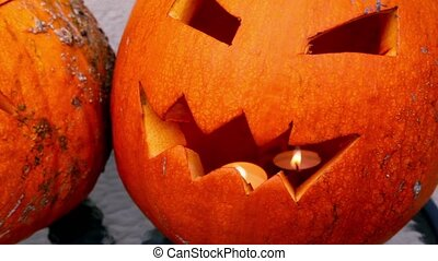 Scary Jack O-Lantern halloween pumpkin with flaming candle...