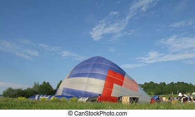 Aerostats are filled with hot air and take off, time lapse