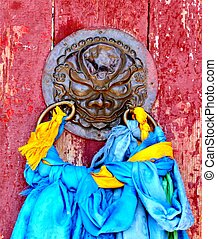 Temple door adorned with prayer scarves