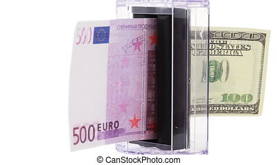 apparatus which changes euro into dollars rotates on white...