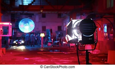 car establish on set in street under light of lamps in red...