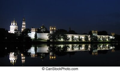 Reflection Novodevichy of monastery is visible in water at...