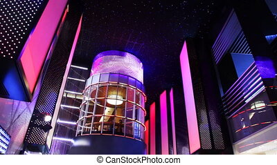 nightclub interiors done as glowing city with tower in...