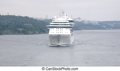 Big cruise liners entered bay in cloudy weather