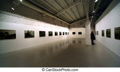 Few people at photography exhibition, panoramic motion