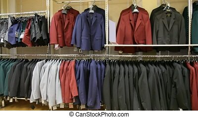panorama of jackets hanging in shop