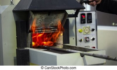 Man opens an annealing furnace, flame goes outside