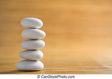 Stone piles symbolize Zen - Pile of white stones symbolizing...