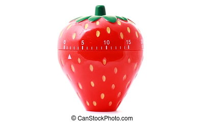 kitchen clock time in form of red strawberry rotates on...
