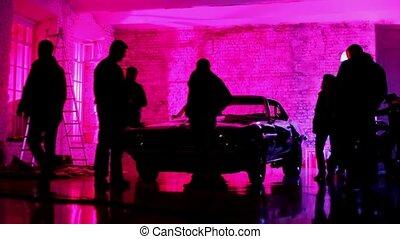 People consider mustang car standing in studio - People...