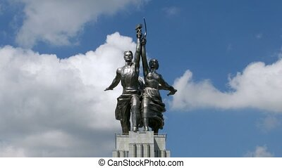 Worker and Kolkhoz Woman monument in front of passing clouds, time lapse