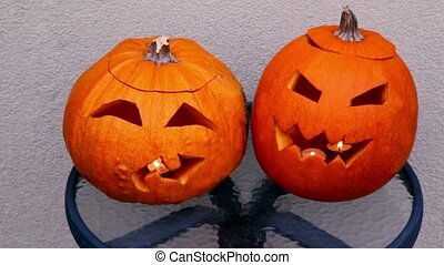 Two pumpkins of halloween lie on table - Two pumpkins of...