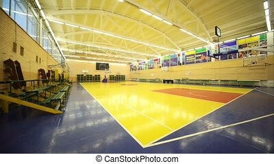 View from corner inside lighted school gym hall