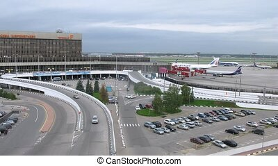 Cars leave and come to terminal F on Sheremetyevo airport,...
