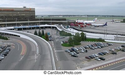 Cars come to building of airport of Sheremetyevo - MOSCOW -...