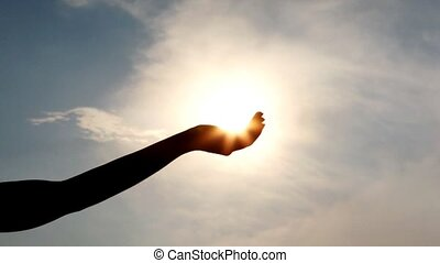 silhouette of one woman hand against sky - silhouette of one...