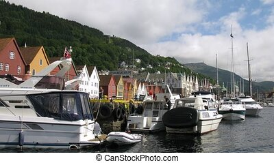 Yachts and motorboats at bay in old Norwegian port, time...