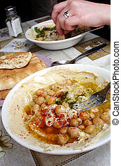 Food and Cuisine - Hummus - Hummus. Mashed chickpeas.