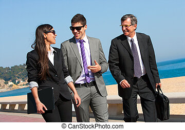 Business team having a walk outdoors - Young business couple...