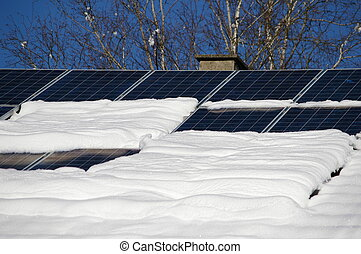 solarcell - solar cells on a snowy roof