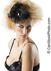 hair style with black accessory of a very beautiful blond girl wearing a black bra lingerie, her body is turned of three quarters at right, she looks in to the lens with serious expression