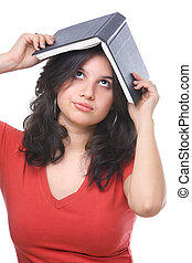 A female teenager holding abook on her head