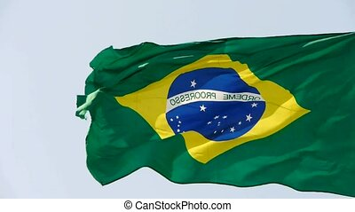Brazil flag flutters in wind.