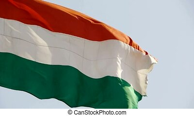 Hungarian flag is fluttering in wind.