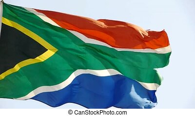 South African flag is fluttering in wind.