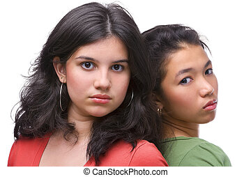 Two female teenager pose cool to camera