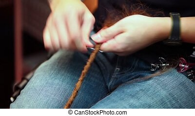 Process of pigtail braiding using special tool, no face are...