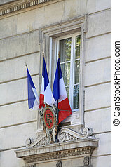 French Flags on the facade of a public building in Avignon, France