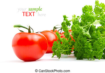 Red tomato with parsley isolated on white background.