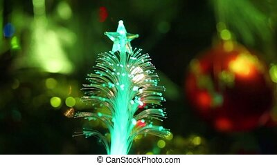 Illuminated souvenir as conifer with star, christmas tree...