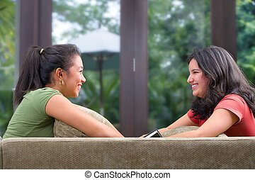 Female teenager sahring time with her friend