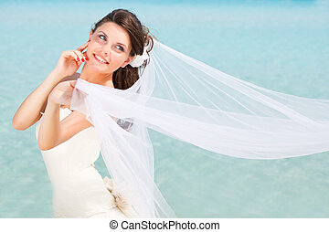 Young bride - Young brunette bride near the blue sea