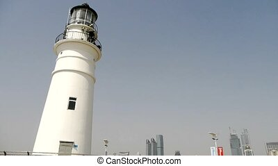 Lighthouse in harbor and Coastal city - Lighthouse in harbor...