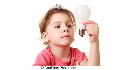 nice little girl plays with bulb in her hands on white...