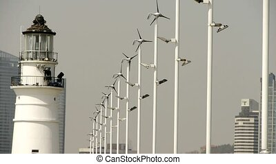 lighthouse and wind turbine & new power energy city.