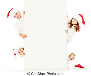 Happy family in Santa's hats with empty white banner for text isolated on white