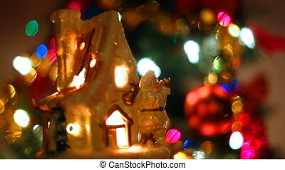 fabulous toy house with Santa Claus near Christmas tree and...