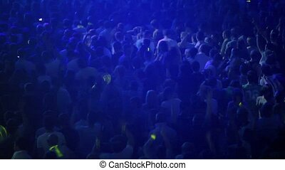 Audience dance at rave party, view from above, dark blue...