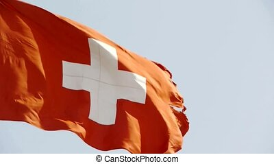 Switzerland flag is fluttering in wind.