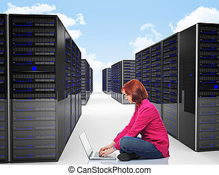 woman in datacenter - woman use laptop in datacenter