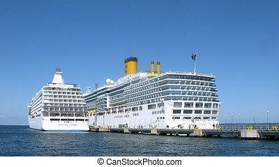 SEVEN SEAS VOYAGER and COSTA LUMINOSA liners at bay -...