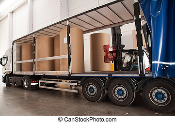 Warehouse paper with forklift - Paper mill - Warehouse paper...