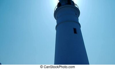 Lighthouse in harbor & Coastal city.